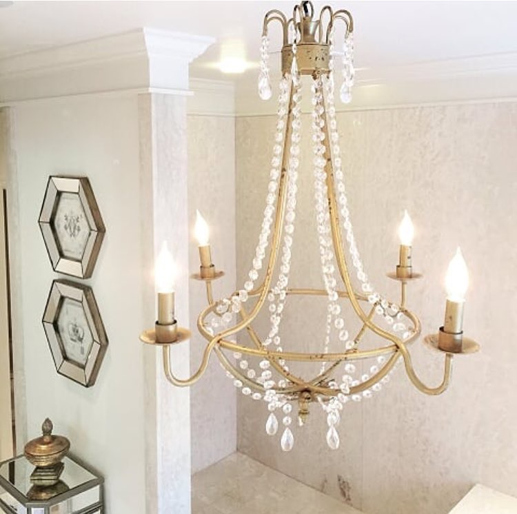 Julie picked this chic chandelier for her master bathroom for added glam.