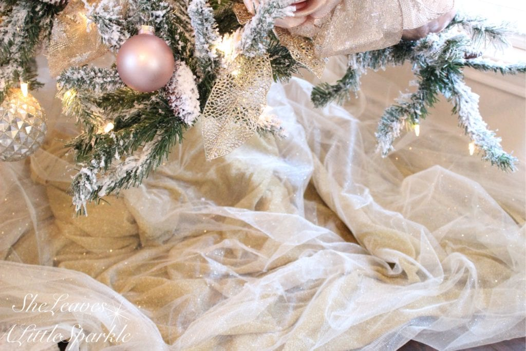 holiday living room tour bloggers home tour blush pink christmas blush gold glam christmas tulle sparkly tree skirt