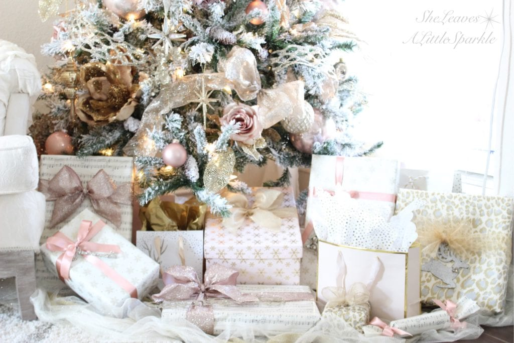 Holiday Living Room Tour blush gold flocked christmas tree blush wrapping paper pink christmas