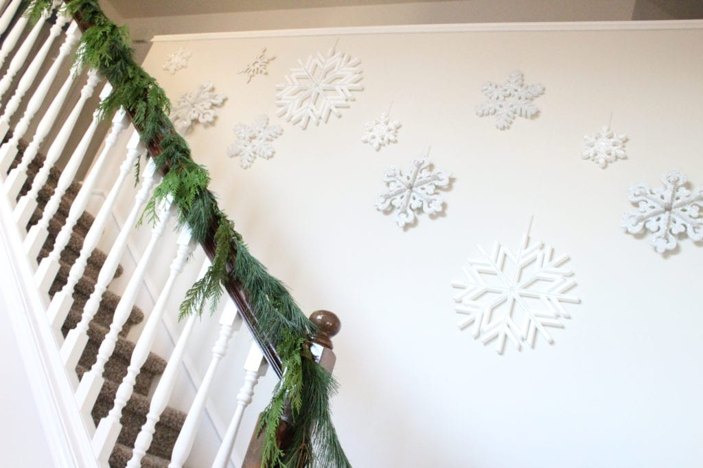 How to hang garland on your banister summer adams for Hanging garland on staircase