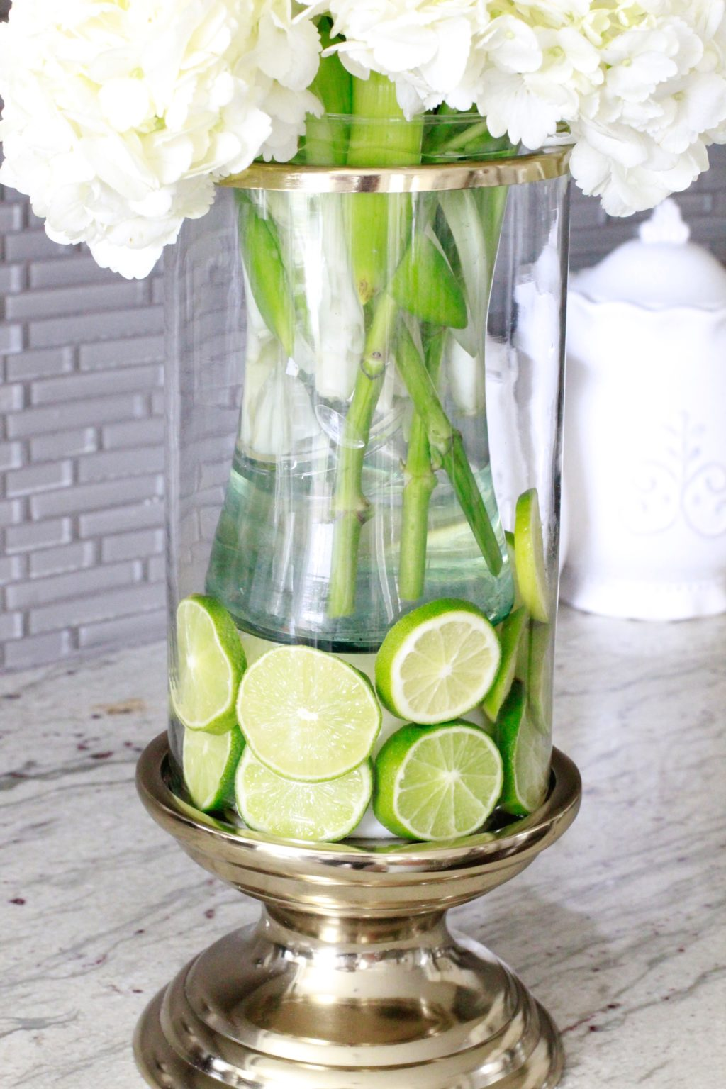 How to create a fruit and floral arrangement summer adams i dropped the vase inside to create a space for the limes reviewsmspy