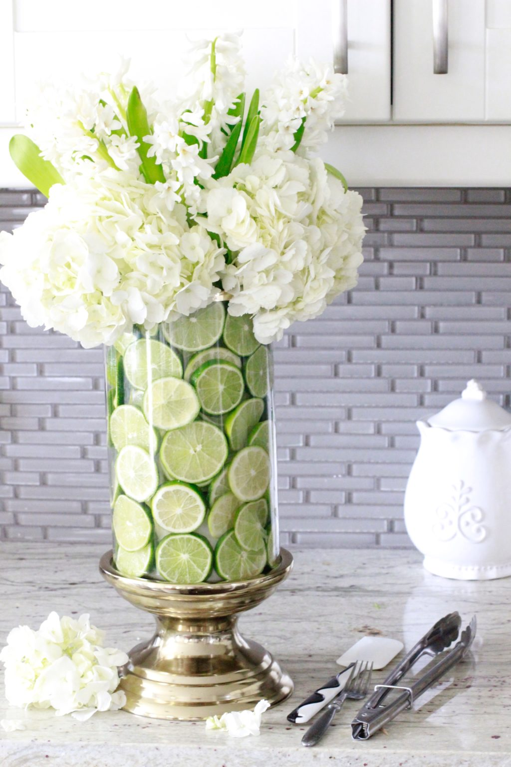 How to create a fruit and floral arrangement summer adams i added 3 huge hydrangeas to the inner vase so that they were just covering the very top of the hurricane vase and lime slices reviewsmspy