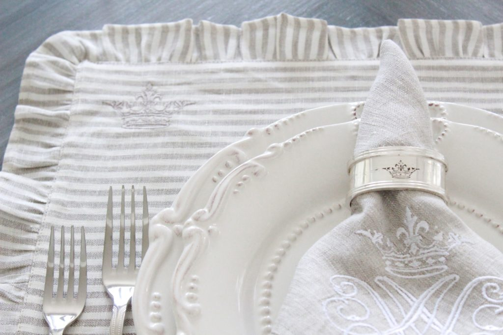 Each Placemat Is Adorned With A Signature Crown.