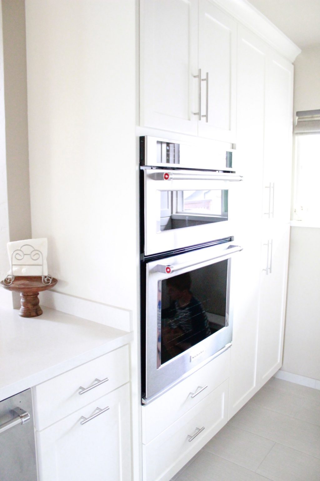 Glass Cabinets Were Used In 2 Of The Cabinet Doors To Display Pretty White  Dishes.