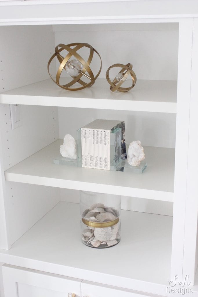 fashion books, fashion coffee table books, style books, blush pink sea glass beads, pineapple ceramic candle, ikea hack shelves, glam style office, decorating with books, styling built-ins shelving
