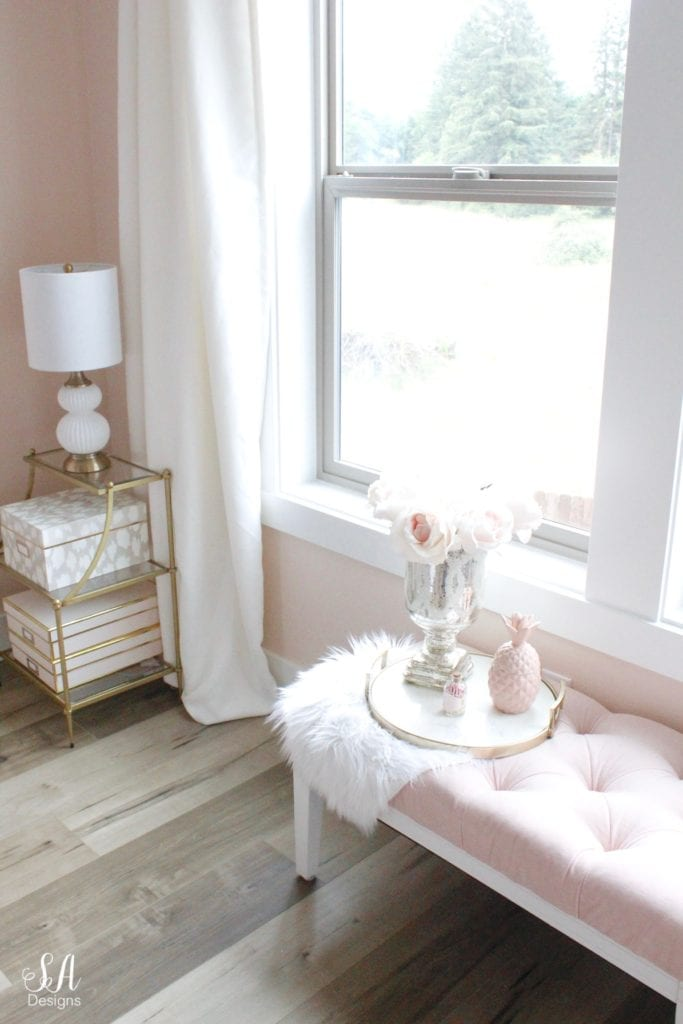blush tufted bench, gold brass etagere end tables shelving