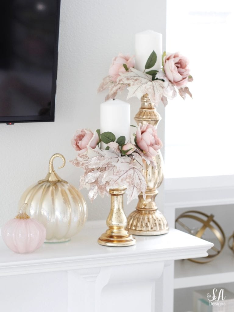 loveliest looks of fall tour 2018 summer adams, blush pink glass pumpkins, homegoods pumpkins, blush glam fall mantel decor, eucalyptus blush pink mauve roses swag, crystorama calypso chandelier, brass gold crystal chandelier, television over mantel mantle, tv above fireplace, mercury glass gold silver candle holders candle rings candle wreaths, fall glam candle rings, blush candle rings, white built-ins, white interiors, white hearth marble tile