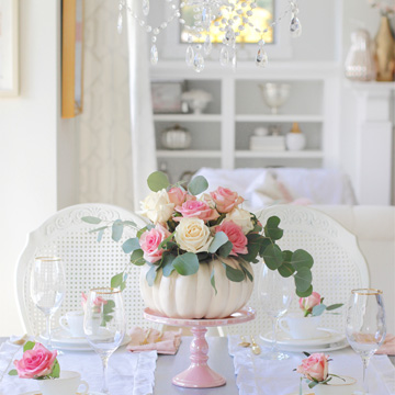 flowers in pumpkin, pumpkin floral arrangement, pink roses, pink cakestand, crystal chandelier, fall table, white interiors, elegant fall table, lovely fall decor, romantic fall decor, french country cottage fall decor