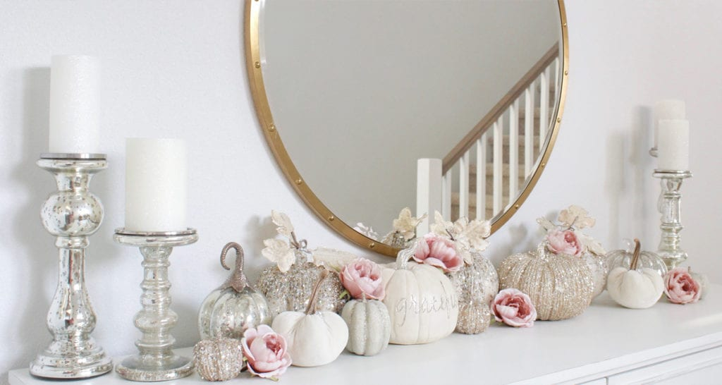 front entry table, white entry table, glitter pumpkins, glam pumpkins, fall pumpkin decor, elegant velvet mercury glass pumpkins, glitter pumpkins decor, round mirror, mercury glass candle holders, caitlin wilson rug jolie collection luna rug, glam fall style, elegant glam fall decor, blue and pink fall decor, blush and blue fall decor